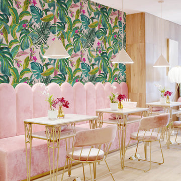 Bright pink tropical removable wallpaper in Palm Springs style living room interior