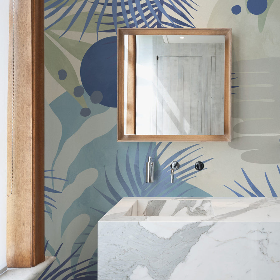 Abstract coastal wall mural wallpaper in chic minimal bathroom interior with marble sink