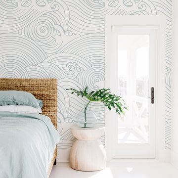 White modern coastal style bedroom interior with oversized waves wall mural wallpaper