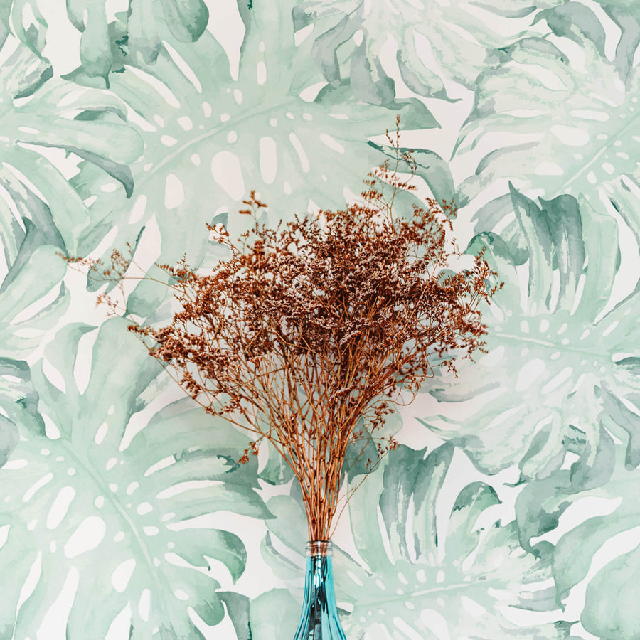 Tropical green palm leaves removable wallpaper by Livettes