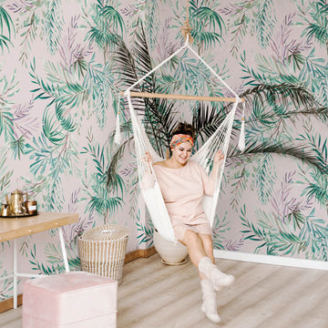 Modern tropical boho bedroom interior with blush pink removable wallpaper