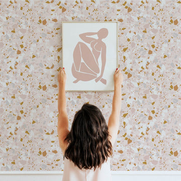 Pastel pink and gold terrazzo design removable wallpaper for powder room and nursery interiors