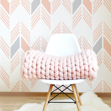 Pastel pink aztec print removable wallpaper in tribal girl's room interior