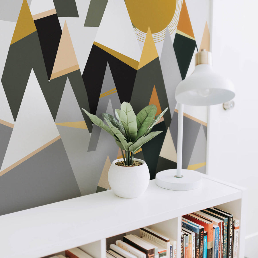Modern mountains wall mural for scandinavian interior with reading nook, white bookcase and white table lamp
