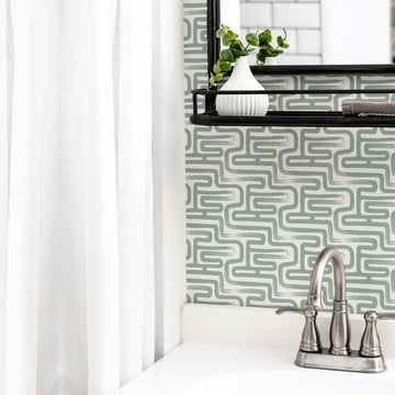 Sage green brush stroke design wallpaper in bathroom interior