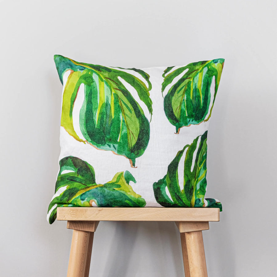Green tropical print washed linen pillow cover with monstera leaves