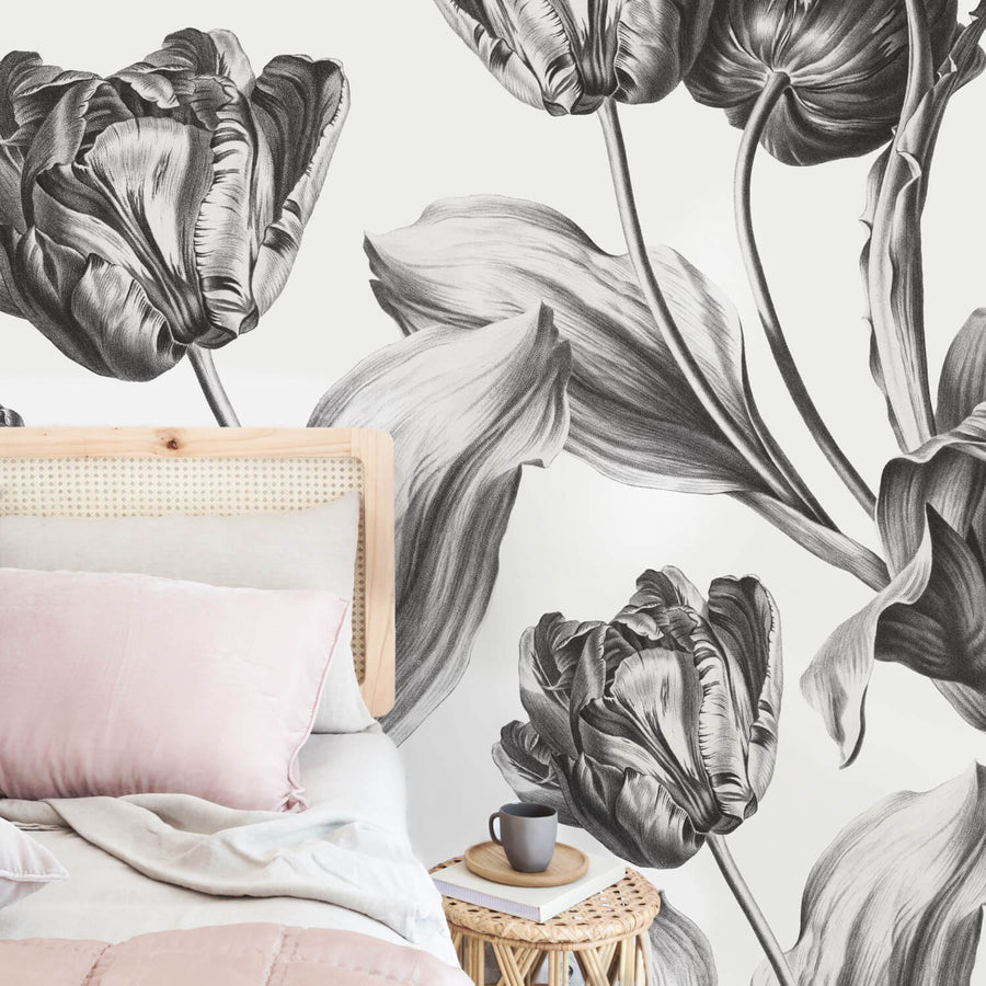 Grey floral wall mural with dutch tulips in pastel pink bedroom interior