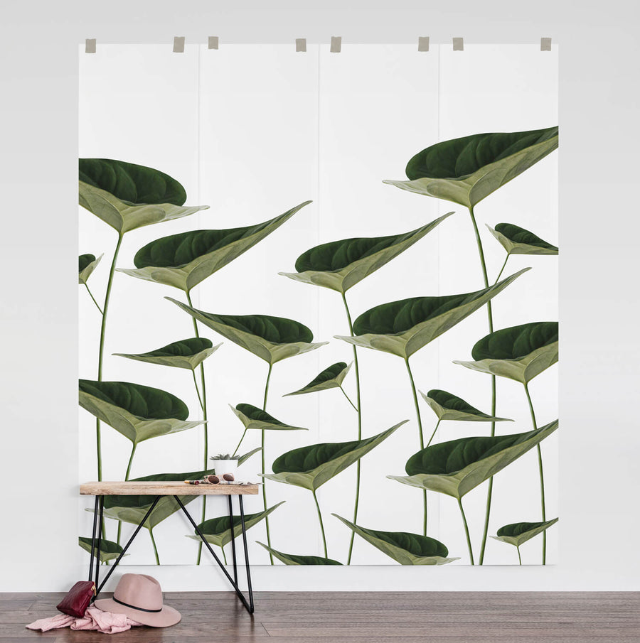 Large botanical leaves wall mural in modern bedroom interior