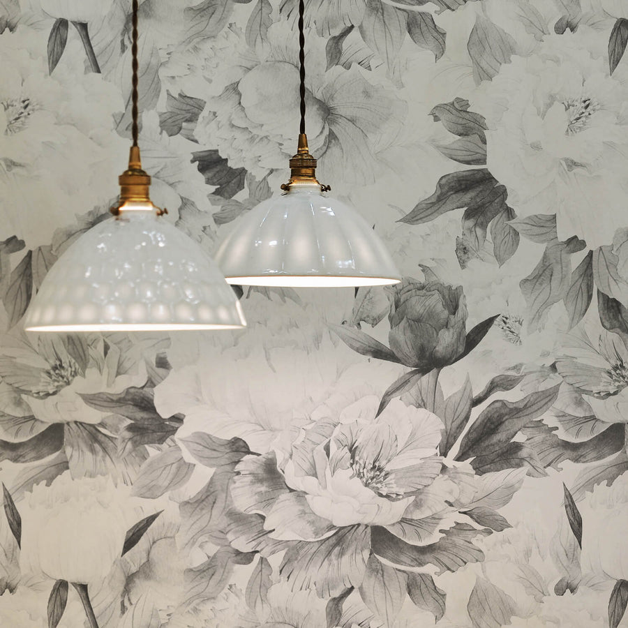 Grey watercolor peonies removable wallpaper in boho style home office interior with white and gold chandeliers