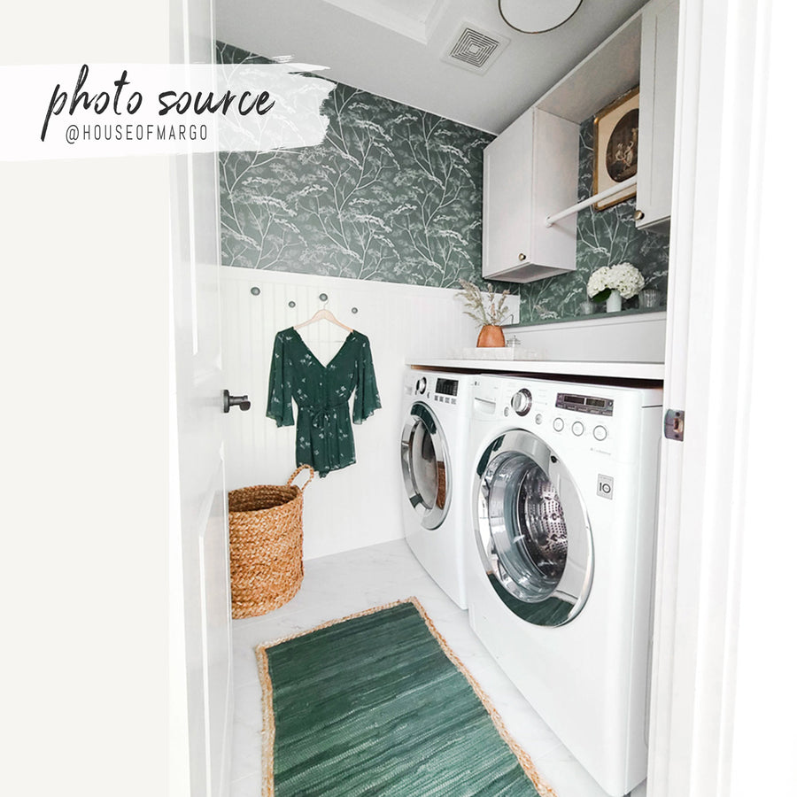 Green and white farmhouse style laundry room with botanical removable wallpaper