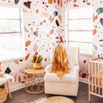 Bohemian nursery interior with oversized terrazzo design wall mural