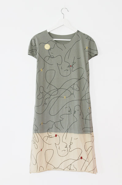 Abstract kissing faces olive T dress