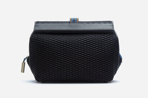 front view of black multi compartment cosmetic case clutch with vegan leather trim