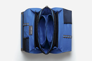 Open blue interior view of Large deluxe cosmetic bag displaying multiple compartments, mesh dividers, and brush holders