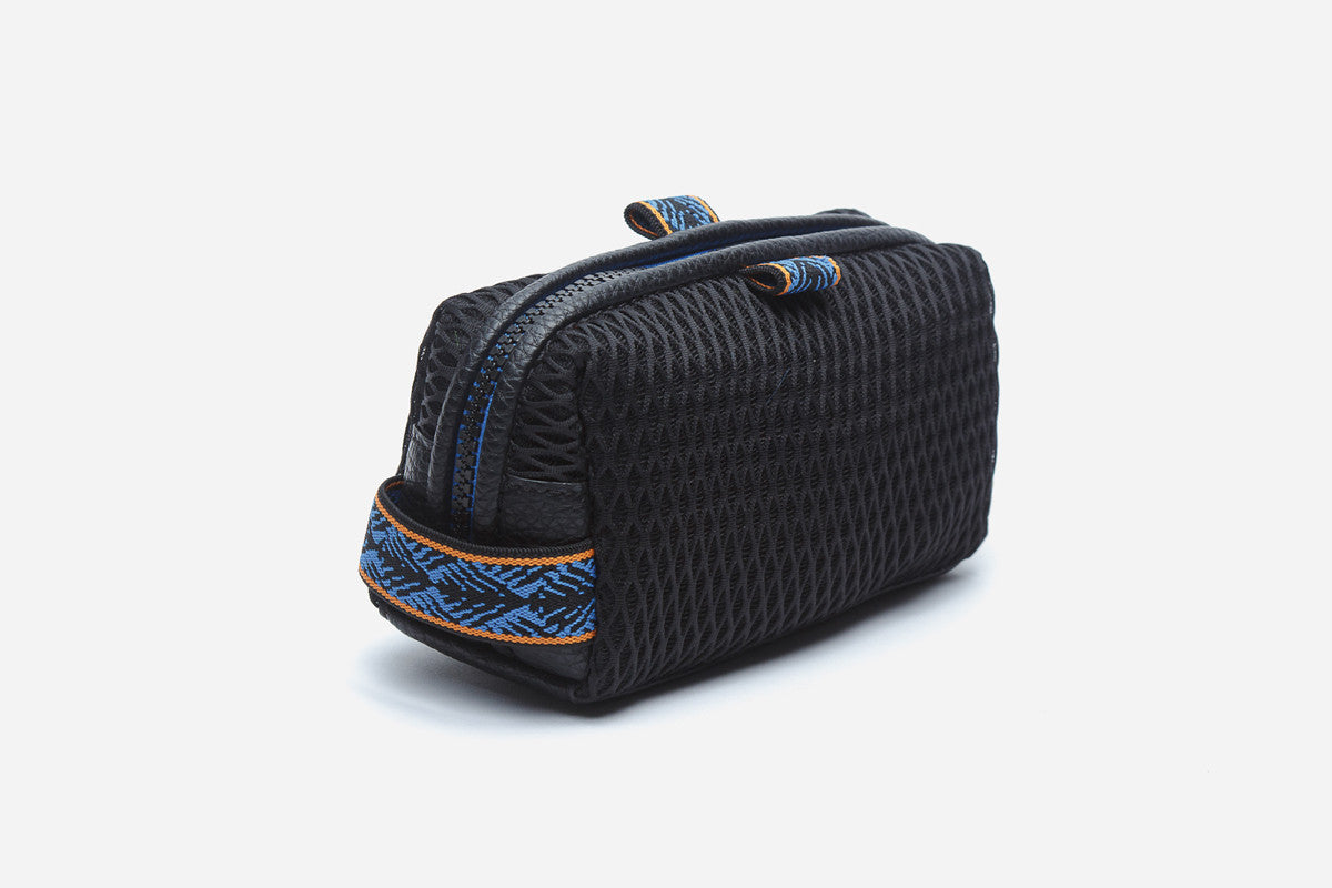 Side angled view of black cosmetic pouchette in blue moon color way