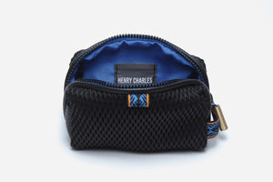 blue interior and black exterior diamond textured fabric of blue moon small cosmetic pouchette