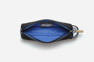 blue Interior of black non toxic pencil case which can fit tiny slip makeup products such as lip pencils and liners
