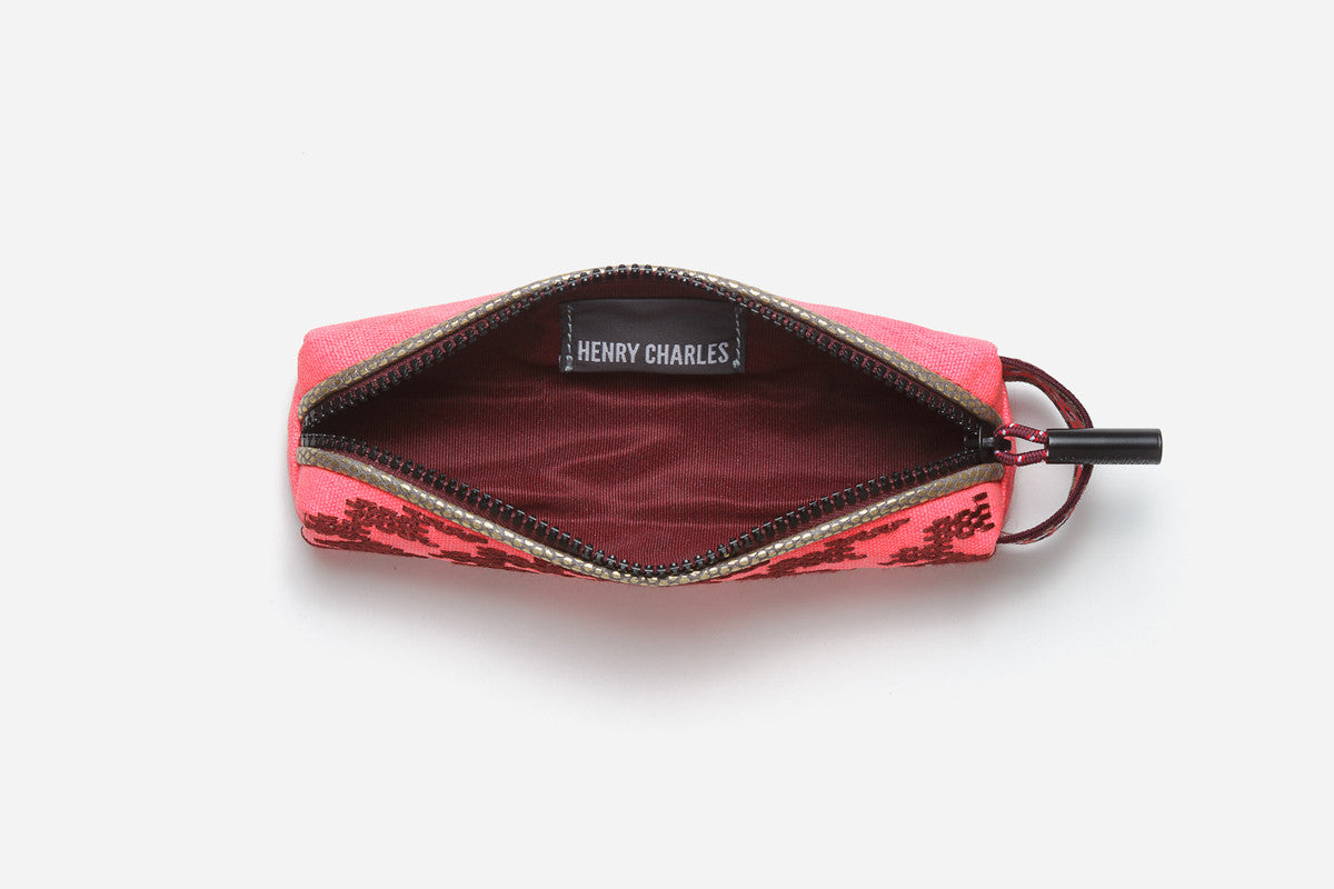 Maroon Interior of pink pencil case which can fit tiny makeup items such as lip pencils and liners