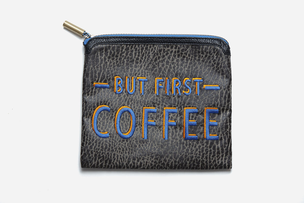 But First Coffee non toxic makeup pouch made of black textured vegan leather and zips up