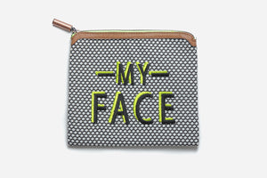 black and white polka dot talk back pouch with brown vegan leather trim and My face embroidered in black and neon green