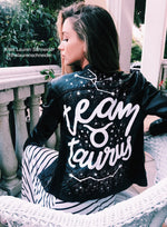 Celebrity Jacket Letterer Lauren Schneider wearing a Team Taurus black jacket with white letters