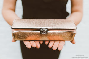 makeup artist claire balest holding henry charles rose gold makeup case bag
