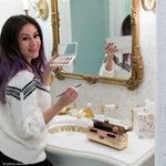 Victoria Escobar using Henry Charles rose gold makeup bag at her vanity