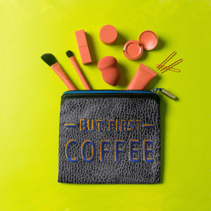 "brushes, eye lash curlers, and 3oz skincare spilling out of Blue Moon ""But First Coffee"" talk back pouch"