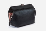 black designer vegan handbag with multiple organization compartments