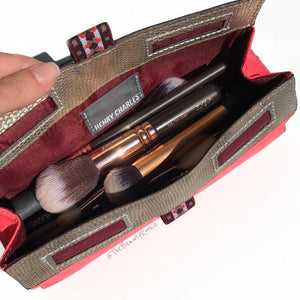 Inside view of brush bag filled with luxury brushes of various shapes and sizes