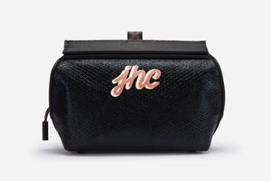 monogramed black vegan makeup handbag front with metallic snakeskin and saffiano trim
