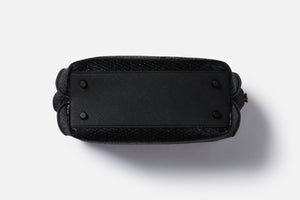black saffiano makeup bag bottom with luxury hardware