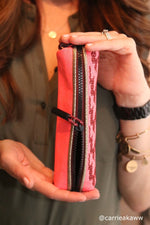 Woman holding zippered pink case for brushes and pencils