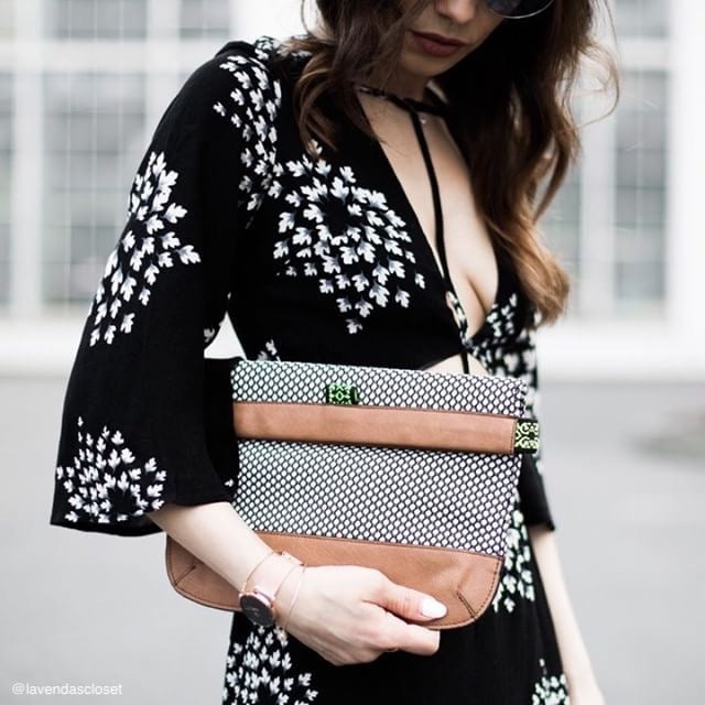 woman holding polkadot handbag clutch for makeup
