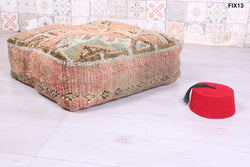 Soft Handmade Moroccan rug pouf with geometric design