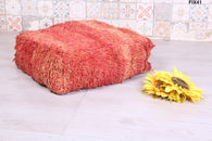 Soft red Moroccan rug pouf