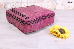 Soft vintage Moroccan rug pouf with checkered design