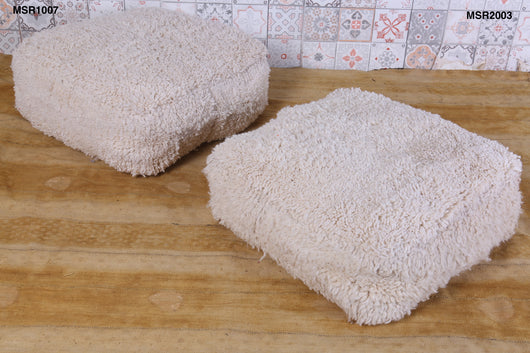 Cozy white Moroccan rug pouf