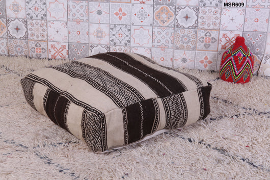 Striking black and white Moroccan kilim pouf