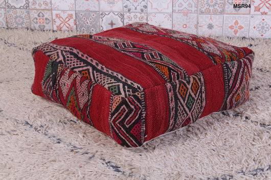 Red Moroccan kilim pouf with embroidery
