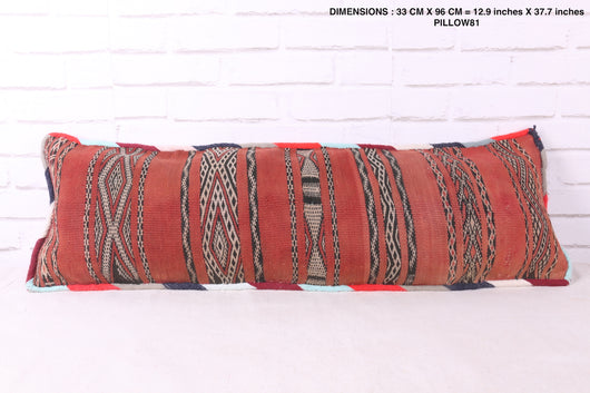 Long, red Moroccan rug pillow