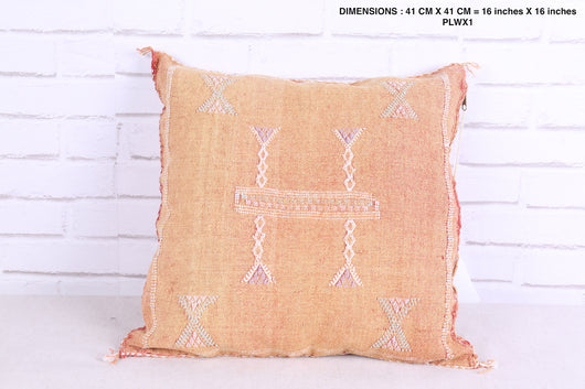 Moroccan rug pillow in faded rose
