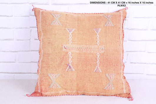 Moroccan rug pillow in faded red