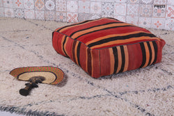 Colorful striped Moroccan kilim pouf