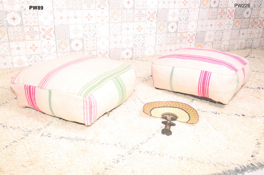 Moroccan kilim pouf with pink and green stripes