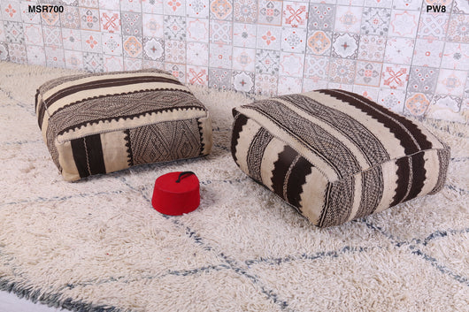 Embroidered black-and-white Moroccan kilim pouf