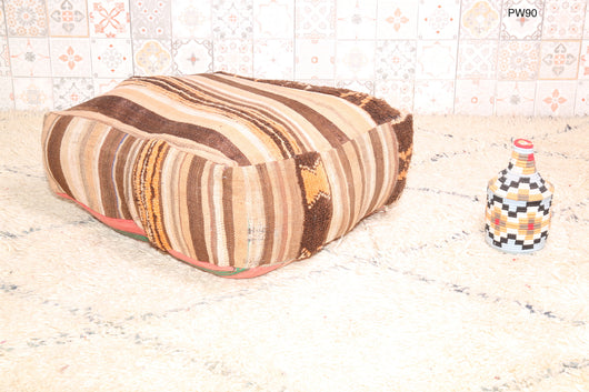 Moroccan kilim pouf in earth colors