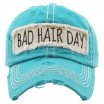 "Vintage, distressed baseball cap featuring ""Bad Hair Day"" embroidered detail.  Turquoise - Southern Style and Stash A Specialty Boutique"