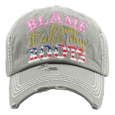 "Vintage, distressed baseball cap featuring ""Blame it all on my Roots"" embroidered detail. - Southern Style and Stash A Specialty Boutique"