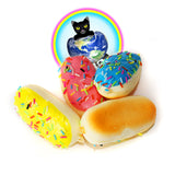 Frosted Eclair Squishy Charms shown in yellow pink and blue from the top and bottom